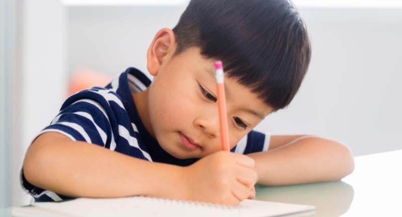 child writing hand right