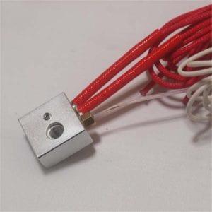 Kırmızı ısı yalıtımlı kabloyla bağlı silindirik seramik ısıtıcı. Şeffaf beyaz kablo ise sıcaklıkölçer (thermistor).